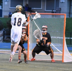 Nick Whitesall with the shot on goal