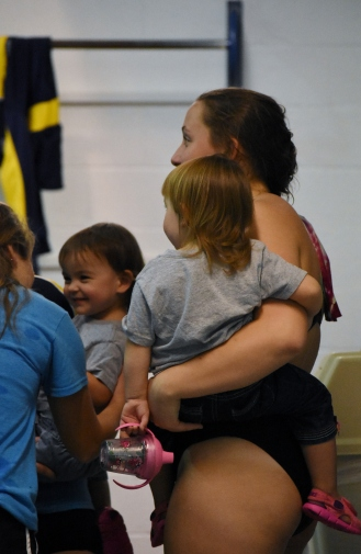 Lily at a meet with her twin sisters