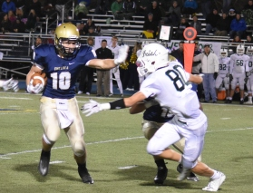 Gus Reynolds powers his way for yardage