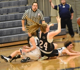 Nicole Bareis fights for a loose ball