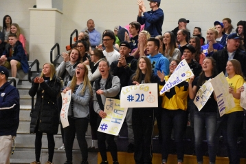 The Chelsea student section react to a big play