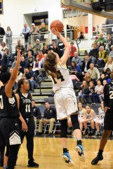 Madeleine Kennedy goes inside for a basket