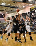 Madeleine Kennedy & Nicole Bareis fight for a loose ball