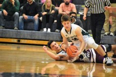 Cook fights for a loose ball