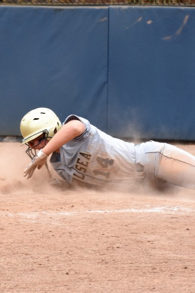 Autumn Johnson Slides safely into home plate