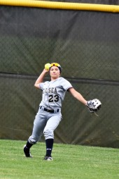 Sydnee Liedel throws the ball back into the infield after a big catch