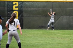 Sydnee Liedel chases down a fly ball in center field