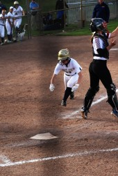 Sydney Hines dives for home on a steal from third