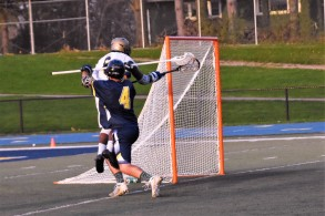 Mikal Nelson jumps high and slams the ball into the net