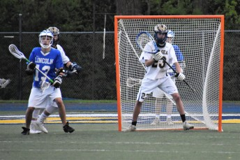 """Senior netminder Josh """"Vinnie"""" Ciaccio stands tall in goal for the shutout"""