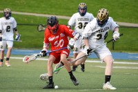 Evan Kucera knocks the ball from a DEvil