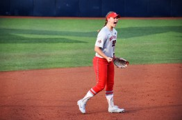 Lilli Piper celebrates a big strikeout by her pitcher Shelby Hursh