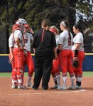 Coach Kelly talks things over with her infield