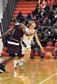 Quinn Starkey goes up against River Rouge in the basketball regionals