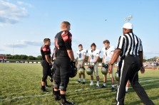 The teams face each other for the coin toss