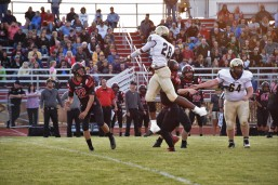 Chelsea's Ronnie Buford jumps to break up a pass