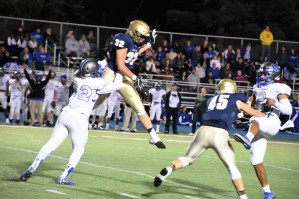 Owen gets air and puts pressure on Lincoln's quarterback
