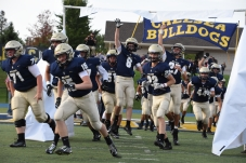 Noah Palmer leaps as he and his teammates take the field