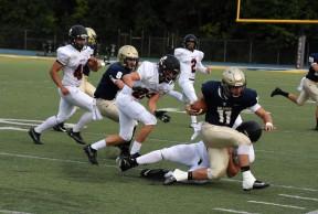 Bulldog quarterback Tomas Steele keeps the ball for a Bulldog first down