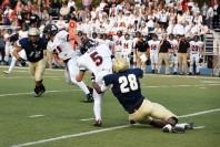 Bulldog Ronnie Buford brings down quarterback Jack Wurzer
