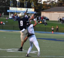 Hunter Neff leaps over a Pirate for a catch