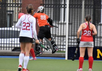 Goalkeeper LIz Tamburro jumps to make a big save